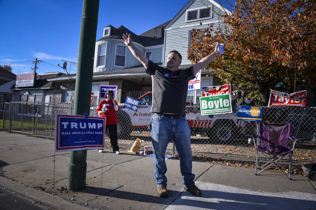 Trump supporter Steve Walls hands out flier and speaks to passersby and potential voters about Donald Trump outside of his Northeast Philadelphia polling place, Nov. 8, 2016.  Charles Mostoller for Reveal